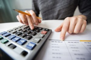 A woman calculating the costs of local moving.