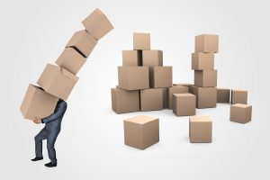 a cartoon drawing of a man carrying a lot of carboard boxes because he is involved in moving preparations