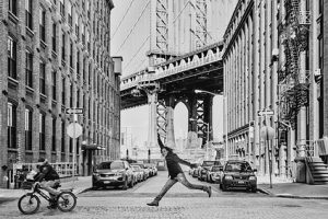 Photo of a man moving to Brooklyn for college with Brooklyn bridge in the background