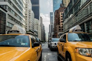 Yellow cabs in a street in NYC.