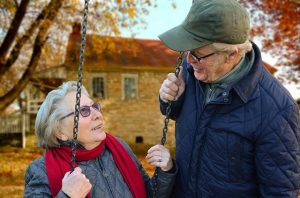 An elderly couple discussing retirement in the countryside.
