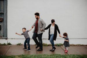 A family going to a New York neighborhood.